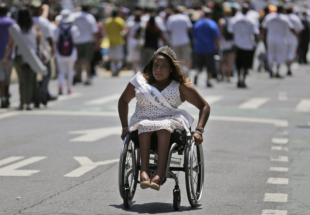 Andrea Dalzell, 2015 Ms. Wheelchair New York, participates in the inaugural Disability Pride Parade, Sunday, July 12, 2015, in New York. (Photo by Seth Wenig/AP Photo)