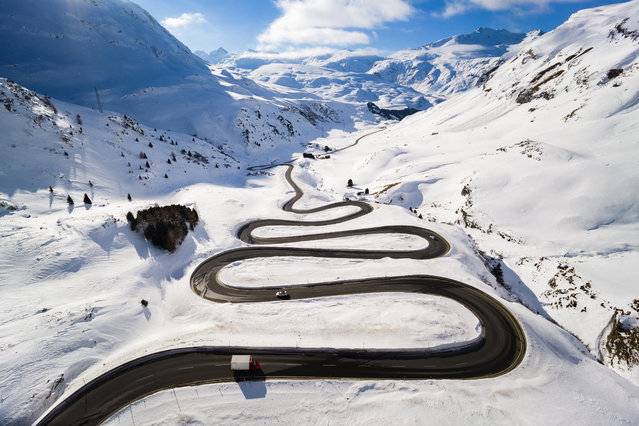 Steep turns on the winding road leading up to the Julierpass that connects the Engadin valley to the rest of the canton of Graubuenden are pictured in Bivio, Switzerland, Thursday, January 24, 2019. (Photo by Valentin Flauraud/Keystone via AP Photo)