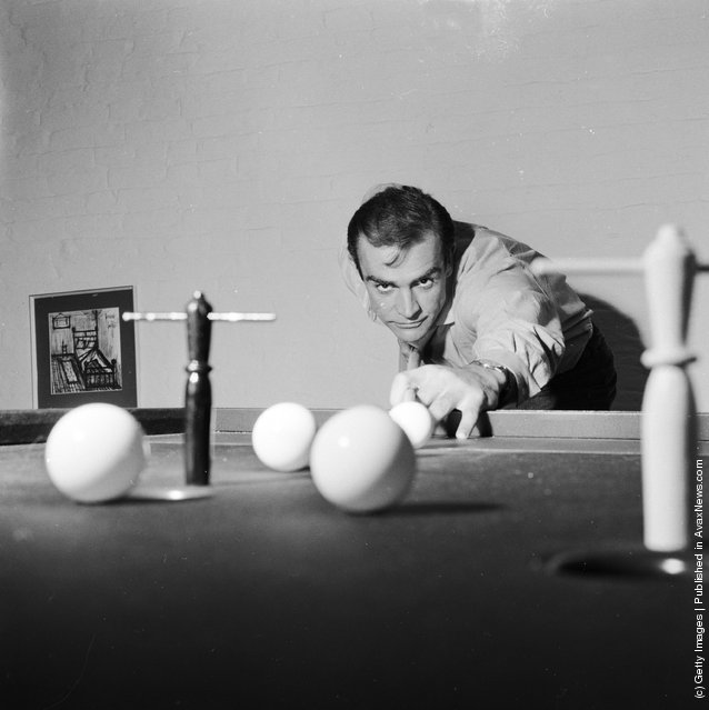 1962: Scottish actor Sean Connery, the new face of superspy James Bond, enjoys a game of bar billiards at his basement flat in London's NW8