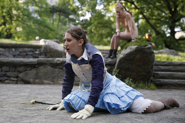 "Kara Lynn, as ""Ferdinand"", and Marisa Roper as ""Miranda"" act during the Outdoor Co-Ed Topless Pulp Fiction Appreciation Society theater company's performance of Shakespeare's ""The Tempest"", in Central Park, Thursday, May 19, 2016, in New York. The group presents a ""stripped-down"" version of Shakespeare's play while celebrating body freedom and free expression celebrate body freedom and free expression, using nudity to dramatize the conflict between the visitors to Prospero's island and its inhabitants. (Photo by Kathy Willens/AP Photo)"