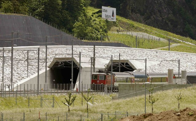 A train drives past the northern gates of the NEAT Gotthard Base Tunnel near the town of Erstfeld, Switzerland March 31, 2016. (Photo by Arnd Wiegmann/Reuters)