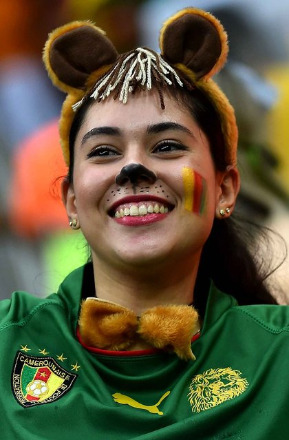 A Cameroon supporter cheers for her team ahead of the Group A football match between Cameroon and Croatia at The Amazonia Arena in Manaus on June 18, 2014, during the 2014 FIFA World Cup. (Photo by Raphael Alves/AFP Photo)