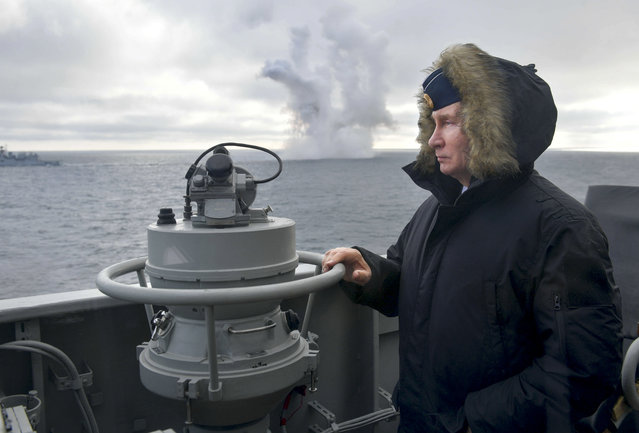 Russian President Vladimir Putin watches a navy exercise from the Marshal Ustinov missile cruiser in the Black Sea in , Crimea, Thursday, Januaru 9, 2020. The drills involved warships and aircraft that launched missiles at practice targets. (Photo by Alexei Druzhinin/Sputnik/Kremlin Pool Photo via AP Photo)