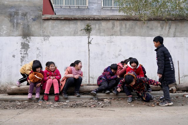Children play at a village ahead of the Chinese Lunar New Year in Zhoukou, Henan province, China on January 13, 2020. (Photo by Jason Lee/Reuters)