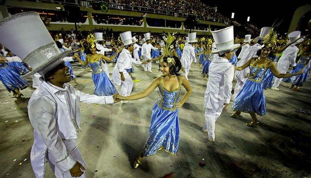 Couples dance during the Sao Clemente samba school's parade at the Sambadrome in Rio de Janeiro