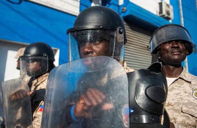 Members of Haiti Police patrol during a march to demand the resignation of President Jovenel Moise, in Port-au-Prince, Haiti, 10 November 2019.Haiti has gone through a new popular uprising sparked by a fuel shortage in the context of a country plagued by corruption, inequality, insecurity and hunger. (Photo by Jean Marc Herve Abelard/EPA/EFE)