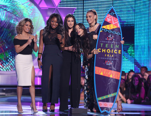 "Ally Brooke, from left, Normani Kordei, Lauren Jauregui, Camila Cabello and Dinah Jane Hansen of Fifth Harmony accept the choice summer song award for ""Worth It"" at the Teen Choice Awards at the Galen Center on Sunday, August 16, 2015, in Los Angeles. (Photo by Matt Sayles/Invision/AP Photo)"
