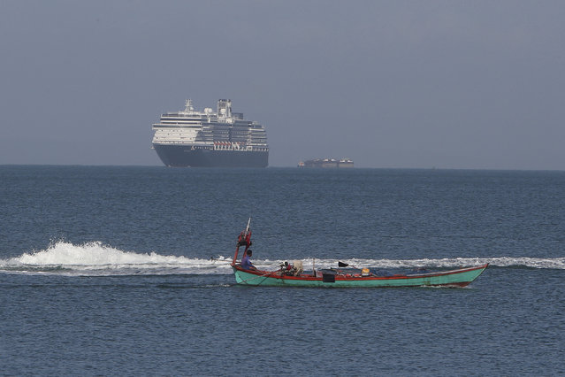The MS Westerdam, owned by Holland America Line, sails off a port of Sihanoukville, Cambodia, Thursday, February 13, 2020. Holland America Line said the ship has been turned away by the Philippines, Taiwan, Japan and Thailand, though its operator said no cases of the disease have been confirmed among the more than 2,200 passengers and crew. (Photo by Heng Sinith/AP Photo)
