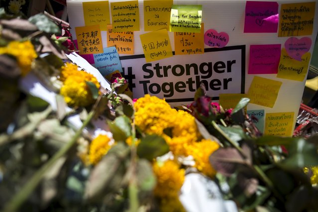 Flowers, notes and a placard are seen at the Erawan shrine, the site of Monday's deadly blast, in central Bangkok, Thailand, August 19, 2015. (Photo by Athit Perawongmetha/Reuters)