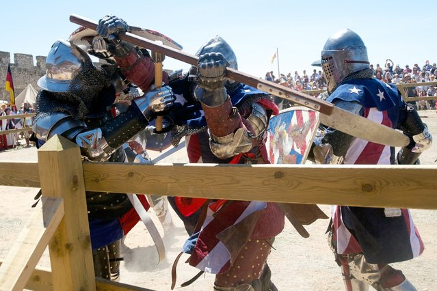 The USA Knights battle during the International Medieval Combat at the castle of Belmonte, May 4, 2014, in Belmonte, Spain. Over 70 people tried out for the national team to represent the United States at the international championships. (Photo by Juan Naharro Gimenez/Getty Images)