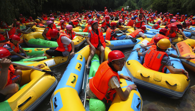 Rafting jam caused by a large number of rafts is seen on August 2, 2014 in Sanmenxia, Henan province of China.  (Photo by ChinaFotoPress/ChinaFotoPress via Getty Images)