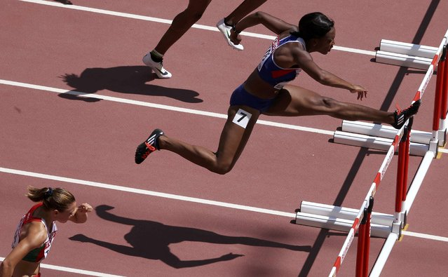 Tiffany Porter of Britain competes as she goes on to win the women's 100 metres hurdles heats during the 15th IAAF World Championships at the National Stadium in Beijing, China August 27, 2015. (Photo by Dylan Martinez/Reuters)