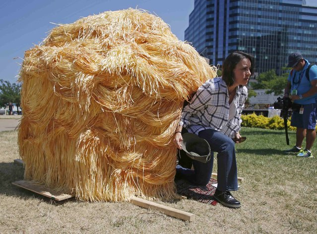 Roxana Casillas, one of the artists behind the Trump Hut, a luxury camping hut modelled on the hairstyle of Republican presidential candidate Donald Trump, exits the den near the Republican National Convention in Cleveland, Ohio, U.S. July 19, 2016. (Photo by Jim Urquhart/Reuters)