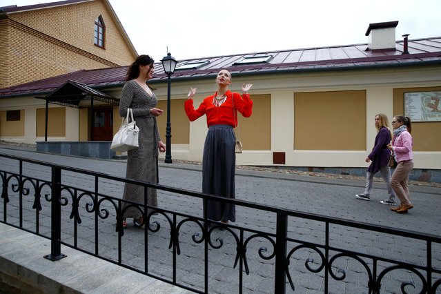 Belarussian rhythmic gymnast Melitina Staniouta (R) walks with her friend in Minsk, June 10, 2016. (Photo by Vasily Fedosenko/Reuters)