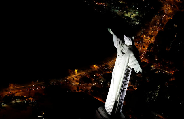 An aerial view of Christ the Redeemer statue standing above Rio de Janeiro, Brazil, less than two weeks before the start of the 2016 Rio Olympic Games, July 23, 2016. (Photo by Ricardo Moraes/Reuters)