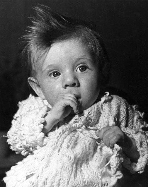 A thumb-sucking baby, circa 1935. (Photo by Fox Photos)