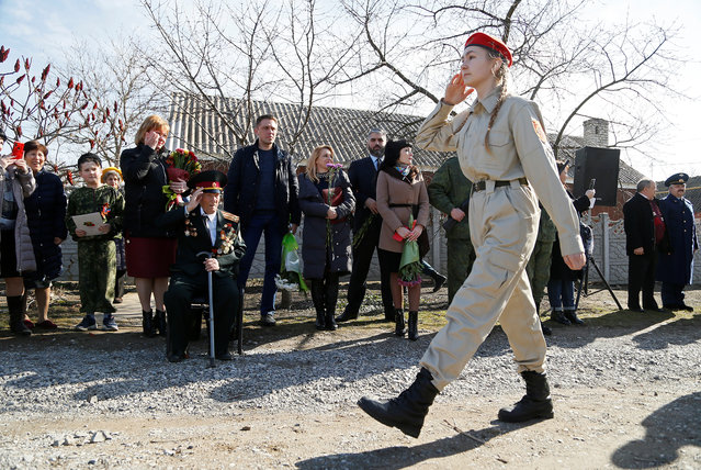 Vladimir Khlapov, a 97-year-old World War Two veteran, salutes during a military parade organized personally for him on his birthday, as part of preparing the celebration of the 75th anniversary of the victory over Nazi Germany in World War Two, in the rebel-controlled town of Dokuchaevsk in Donetsk region, Ukraine on March 4, 2020. (Photo by Alexander Ermochenko/Reuters)
