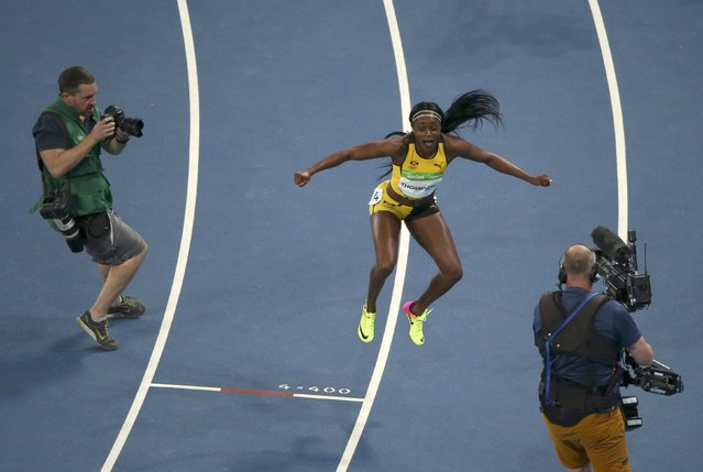2016 Rio Olympics, Athletics, Final, Women's 100m Final, Olympic Stadium, Rio de Janeiro, Brazil on August 13, 2016. Elaine Thompson (JAM) of Jamaica celebrates her gold medal in the women's 100 meters. (Photo by Carlos Barria/Reuters)