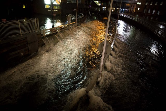 Seawater floods the entrance to the Brooklyn Battery Tunnel in New York. (Photo by John Minchillo/Associated Press)