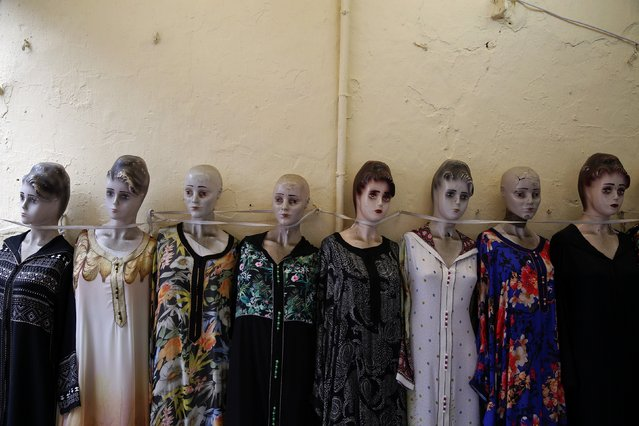 Mannequins displaying women's clothing for sale are lined against the wall in Rabat's Medina September 21, 2014. (Photo by Damir Sagolj/Reuters)
