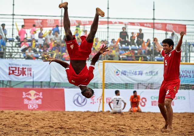 Yahya Al Araimi of Oman celebrates scoring with his teammate Mandhar Hilal, right, during the Continental Beach Soccer Tournament match between Oman and Lebanon at Municipal Sports Center, August 23, 2016, in Ordos, China. (Photo by Manuel Queimadelos Alonso/Getty Images)