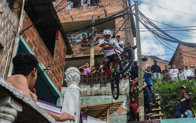 Colombia's downhill rider David Gomez competes during the Urban Bike Inder Medellin race final at the Comuna 1 shantytown in Medellin, Antioquia department, Colombia on November 19, 2017. (Photo by Joaquin Sarmiento/AFP Photo)