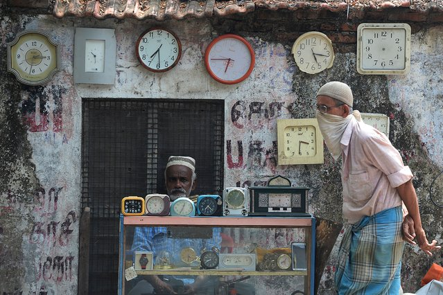 A watchmaker waits for customers during a government-imposed nationwide lockdown as a preventive measure against the COVID-19 coronavirus in Chennai on June 29, 2020. (Photo by Arun Sankar/AFP Photo)