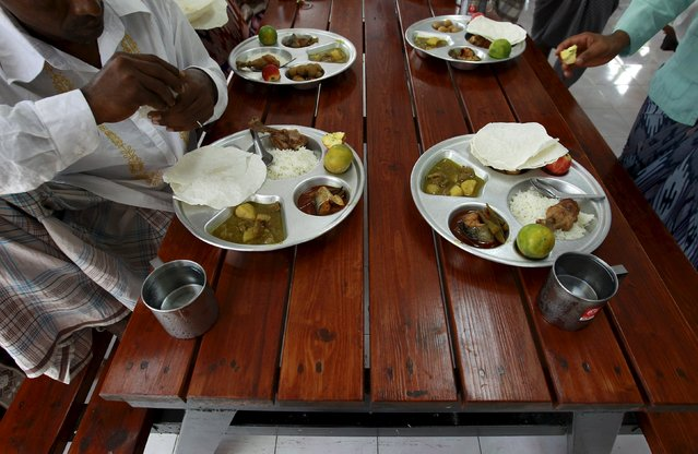 Rohingya Muslims who were trafficked eat together during an Eid-al-Adha celebration at a shelter in Pathum Thani province, on the outskirts of Bangkok, Thailand, September 24, 2015. Muslims across the world celebrate the annual festival of Eid al-Adha or the Feast of the Sacrifice. (Photo by Chaiwat Subprasom/Reuters)