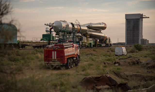 The Soyuz MS-01 spacecraft is rolled out by train to the launch pad at the Baikonur Cosmodrome, Kazakhstan, Monday, July 4, 2016. NASA astronaut Kate Rubins, cosmonaut Anatoly Ivanishin of the Russian space agency Roscosmos, and astronaut Takuya Onishi of the Japan Aerospace Exploration Agency (JAXA) will launch from the Baikonur Cosmodrome in Kazakhstan the morning of July 7, Kazakh time (July 6 Eastern time.) All three will spend approximately four months on the orbital complex, returning to Earth in October. (Photo by Bill Ingalls/NASA)