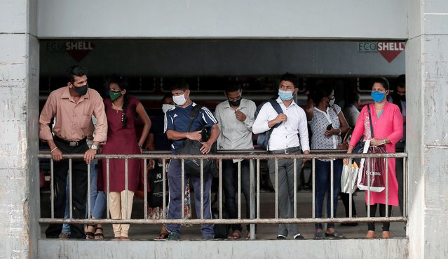 Passengers wearing protective masks wait for a bus at a main bus station, amid coronavirus disease (COVID-19) concerns, in Colombo, Sri Lanka, June 29, 2020. (Photo by Dinuka Liyanawatte/Reuters)
