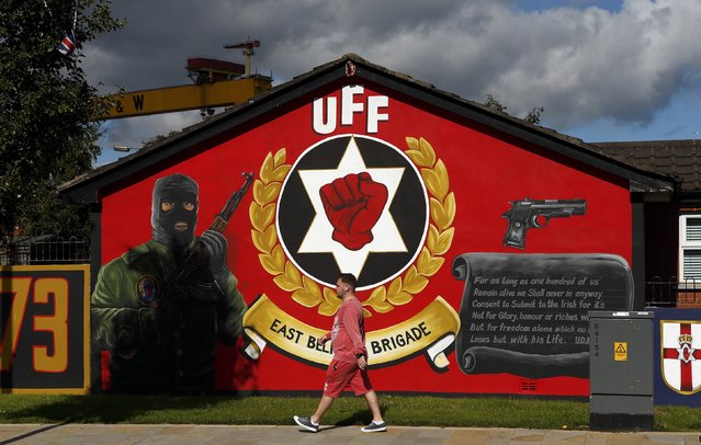 A man walks past a mural in East Belfast in Northern Ireland, September 18, 2015. (Photo by Cathal McNaughton/Reuters)