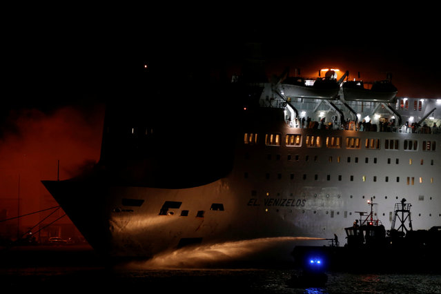 Smoke rises from the Eleftherios Venizelos ferry as a firefighting vessel tries to extinguish a fire on the ferry, at the port of Piraeus, Greece on August 29, 2018. (Photo by Alkis Konstantinidis/Reuters)