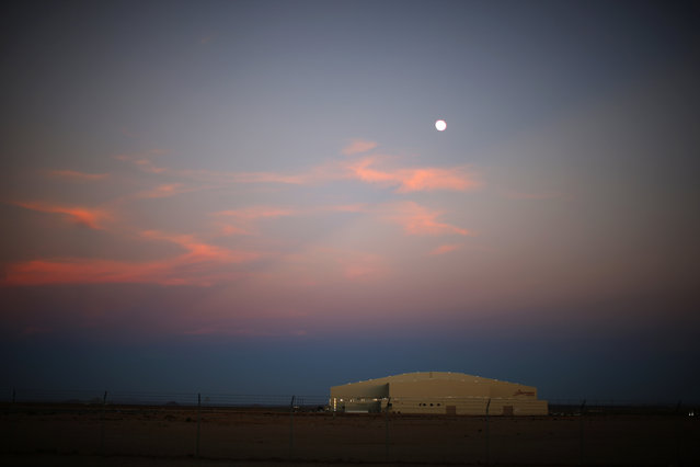 The moon rises over a hangar at the Mojave Air and Space Port in Mojave. (Photo by Lucy Nicholson/Reuters)