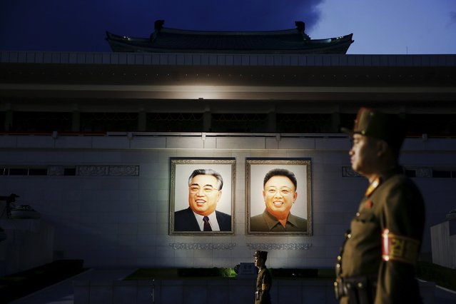 Soldiers guard a grand stand decorated with portraits of North Korea's founder Kim Il-sung (L) and former leader Kim Jong-il after the parade celebrating the 70th anniversary of the founding of the ruling Workers' Party of Korea, in Pyongyang October 10, 2015. (Photo by Damir Sagolj/Reuters)