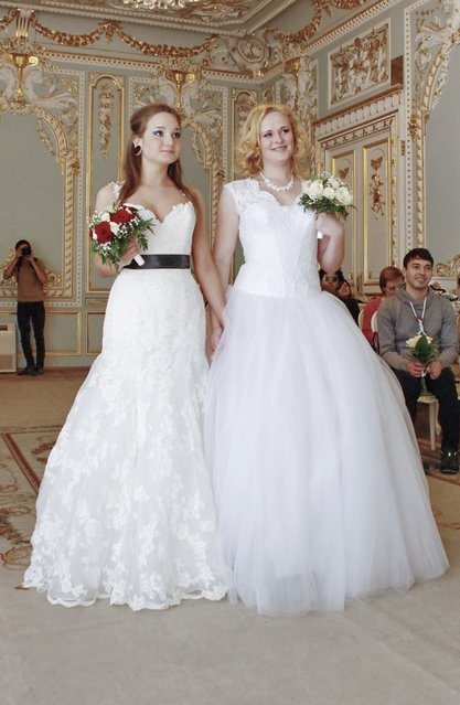 Two brides attend their wedding ceremony to each other at the wedding registry office in St. Petersburg November 7, 2014. (Photo by Reuters/Stringer)