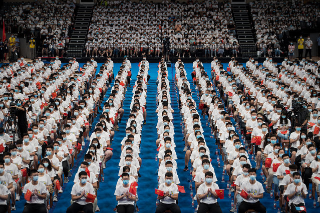 Students at the Huazhong University of Science and Technology attend a commencement ceremony in a gymnasium in Wuhan, in China's central Hubei province on September 4, 2020. More than 7000 students attended the ceremony. (Photo by AFP Photo/China Stringer Network)
