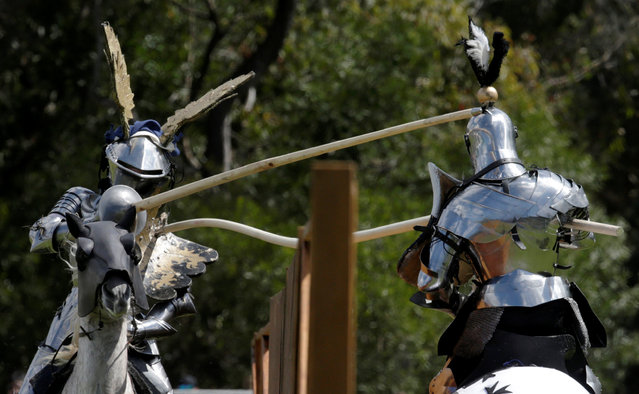 Australian Cliff Marisma's lance (R) bends moments before breaking on the shield of Arne Koets from the Netherlands during the jousting tournament at the St Ives Medieval Fair in Sydney, one of the largest of its kind in Australia, September 24, 2016. (Photo by Jason Reed/Reuters)