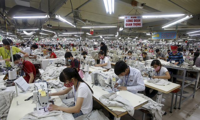 Labourers work at a garment factory in Bac Giang province, near Hanoi October 21, 2015. Vietnam's textiles and footwear would gain strongly from the TPP, after exports of $31 billion last year for brands such as Nike, Adidas, H&M, Gap, Zara, Armani and Lacoste. (Photo by Reuters/Kham)