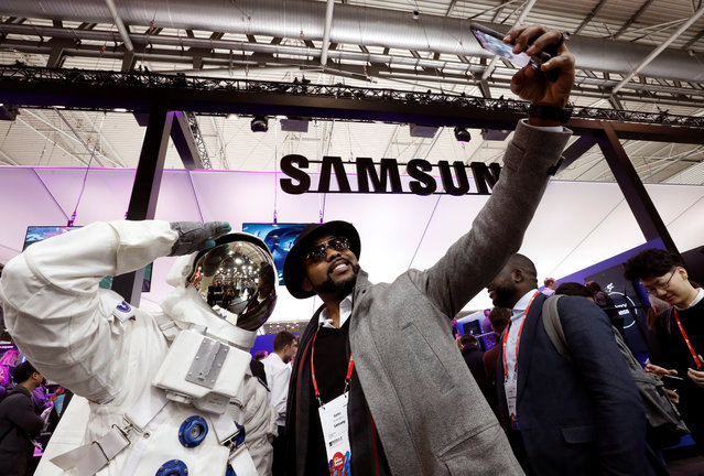 A visitors takes a selfie at Samsung booth during the Mobile World Congress in Barcelona, Spain, February 27, 2018. (Photo by Yves Herman/Reuters)