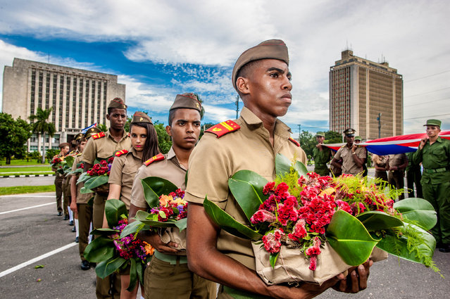 Military school cadets take part in a ceremony commemorating the 56th anniversary of the death of Camilo Cienfuegos who, along with Fidel Castro and Che Guevara, was a chief commander of the Cuban revolution in Havana, Cuba on October 28, 2015. (Photo by Xinhua/REX Shutterstock)
