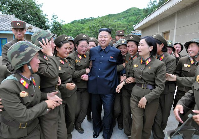 North Korean leader Kim Jong-un (C) visits the Thrice Three-Revolution Red Flag Kamnamu (persimmon tree) Company under the Korean People's Army Unit 4302 in this undated picture released by the North's official KCNA news agency in Pyongyang on August 24, 2012. (Photo by Reuters/KCNA)