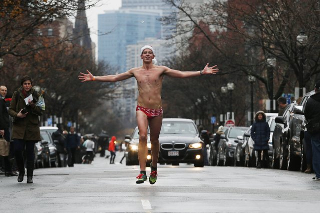 A runner takes part in the 15th annual Santa Speedo Run, a charity run through the streets of the Back Bay, in Boston, Massachusetts December 6, 2014. (Photo by Brian Snyder/Reuters)