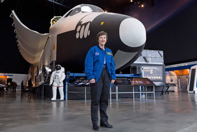 Wendy Lawrence, 58, a retired US Navy captain and former NASA astronaut, is pictured on the Space Shuttle trainer that was used for astronaut's training at the Museum of Flight in Seattle, Washington on February 28, 2018. (Photo by Jason Redmond/AFP Photo)