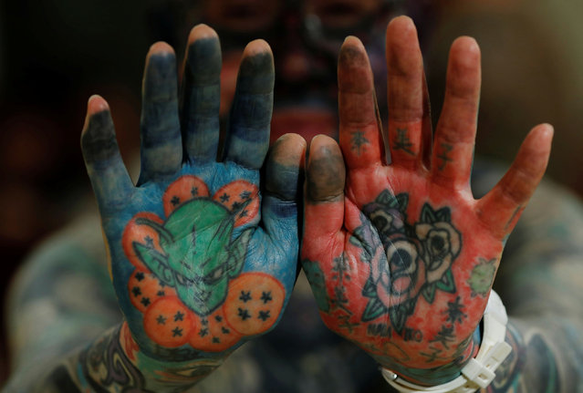 "Author Hiroki Takamura, 62, shows tattoos on his palms at the annual gathering of the Irezumi Aikokai (Tattoo Lovers Association) in Tokyo, Japan, February 16, 2020. ""In the 2000s, tattoo magazines began to increase and even women began to get more tattoos. I thought there was hope that tattoos would finally be accepted the way they are in Europe"", said Takamura. (Photo by Kim Kyung-Hoon/Reuters)"