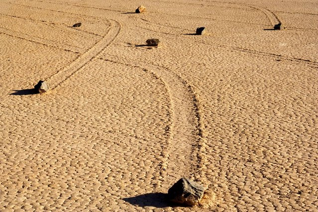 The sliding stones of Death Valley, California – The movement of the rocks continue to baffle experts, with some rocks sliding across a perfectly flat bed despite weighing up to 700 pounds each. (Photo by Alexandra Sailer/Ardea/Caters News)