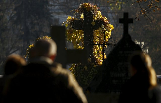 People visit the Powazki cemetery during All Saints Day in Warsaw, Poland November 1, 2015. (Photo by Kacper Pempel/Reuters)