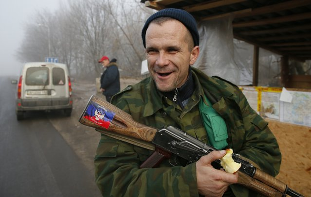 A pro-Russian rebel guards at the checkpoint outside of the town of Gorlovka northeast of Donetsk December 14, 2014. (Photo by Maxim Shemetov/Reuters)