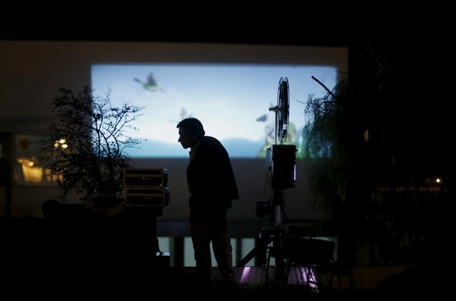 Projectionist Antonio Feliciano, 75, shows a film during a projection in Castro Verde, Portugal August 31, 2013. (Photo by Rafael Marchante/Reuters)