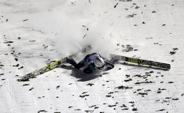 Simon Ammann from Switzerland crashes during the final jumping of the 63rd four-hills Ski jumping tournament in Bischofshofen, January 6, 2015. (Photo by Dominic Ebenbichler/Reuters)