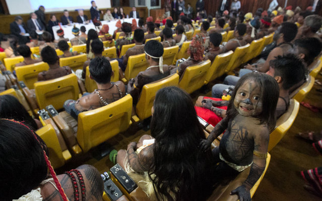 A Munduruku Indian child is pictured at the Planalto Palace, where a meeting with Minister of the General Secretariat of the Presidency of Brazil Gilberto Carvalho was being held with other Munduruku Indians, in Brasilia, June 4, 2013. (Photo by Ed Ferreira/Estadão Conteúdo)